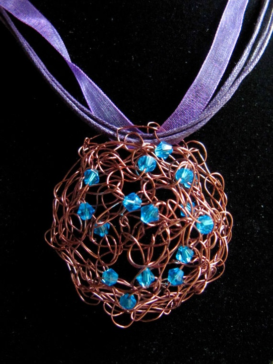 Abstract Copper Wire With Turquoise Crystal Pendent On a Purple Ribbon and Cord Necklace. $25.00, via Etsy.