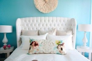 Love the contrast of the white bed on the pale blue wall!