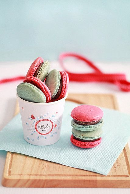 Charmingly adorable red and green Christmas macarons. #cookies #macarons #Christmas #food #baking #dessert #red #green #cute