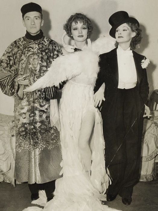 Clifton Webb, Marlene Dietrich and Elizabeth Allan at Basil Rathbone's Halloween party, 1935.- Does anyone think this Swan dress may have been the inspiration for Bjorks ill-fated Oscars dress???