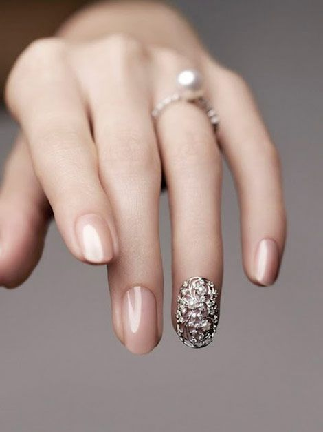 Nude nails and bling.