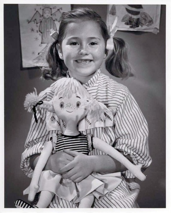 """Girl holding what may be a """"look-alike"""" doll. Great photo from the 1950's."""