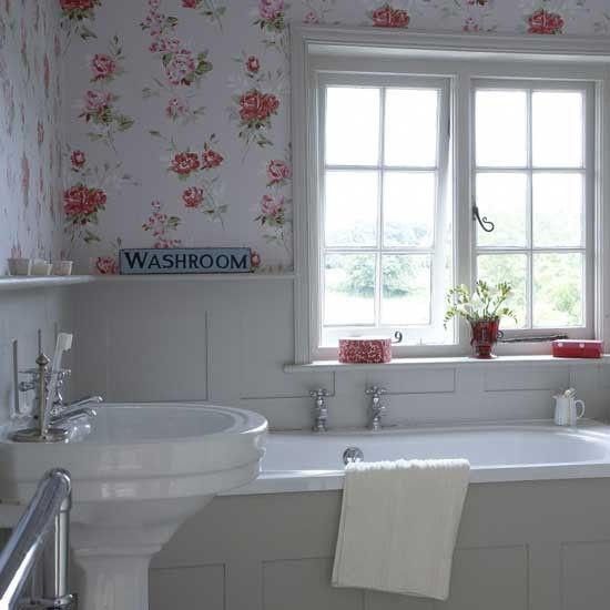 Small floral bathroom Although an all-white bathroom is the best way to keep a small bathroom feeling spacious, a bold country wallpaper is great for making an impact. One or two red accessories work as subtle accent pieces, and complement the wallpaper.  Small floral bathroom