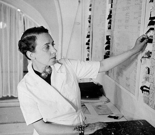 Elsa Schiaparelli at work designing surrealist fashions