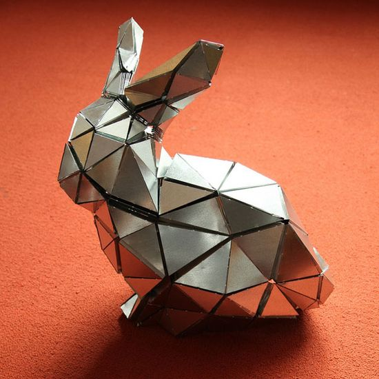 The Stanford Bunny is a computer graphics rendering of a 3D scan of a model ceramic rabbit in 1994 resulting in an array of 69,451 triangles. Here it is rendered in folded metalby a team at MIT. #Stanford_Bunny #MIT