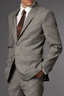 Light grey suit, white shirt, brown tie