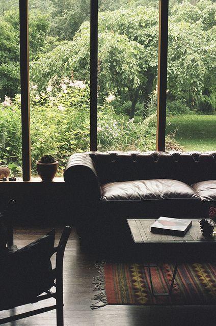 Leather sofa, kilim, perfect lush green garden, big windows