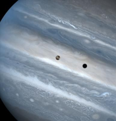 Jupiter and its moon Io. Io's shadow is visible on the planet's surface. (Hubble)