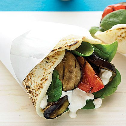 Grilled Eggplant Naan Wraps with Tahini-Yogurt Dressing Recipe by sunset.com via myrecipes: You may want to make extra, because leftovers are fantastic for lunch the next day. #Wrap #Naan #Eggplant #Tahini #Yogurt #sunset_com #myrecipes