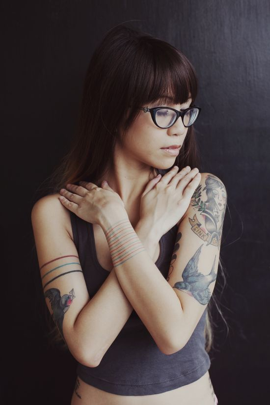 Love her hair, tattoos, glasses, etc! I think she is beautiful!