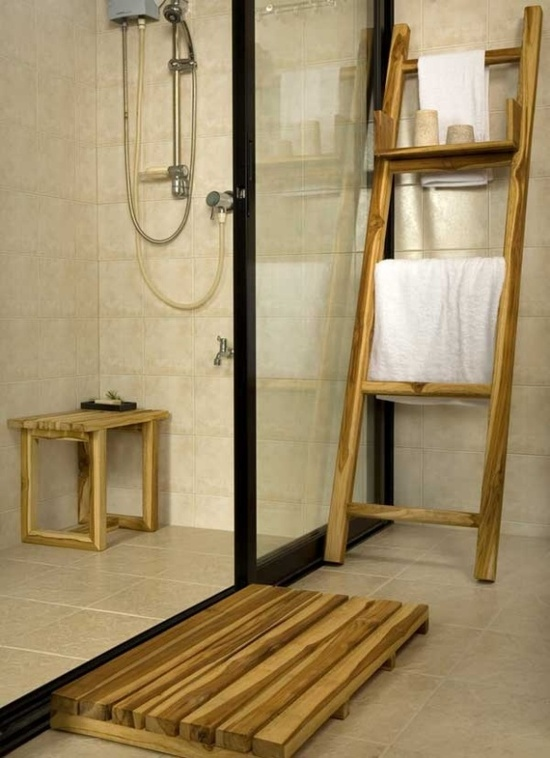 White bathroom with wooden accents for stand-up shower