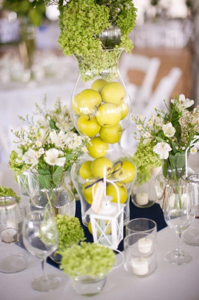 Fresh fruit and Alstroemeria - voila! Fairly inexpensive & beautiful centerpieces.