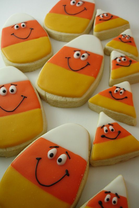 These Smiley Candy Corn Cookies would be adorable at the candy-corn themed party I hope to have one year!