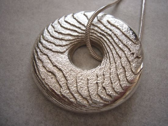fabulous cuttlefish bone cast silver.  such wonderful texture!  by etsy KatrinaNewman
