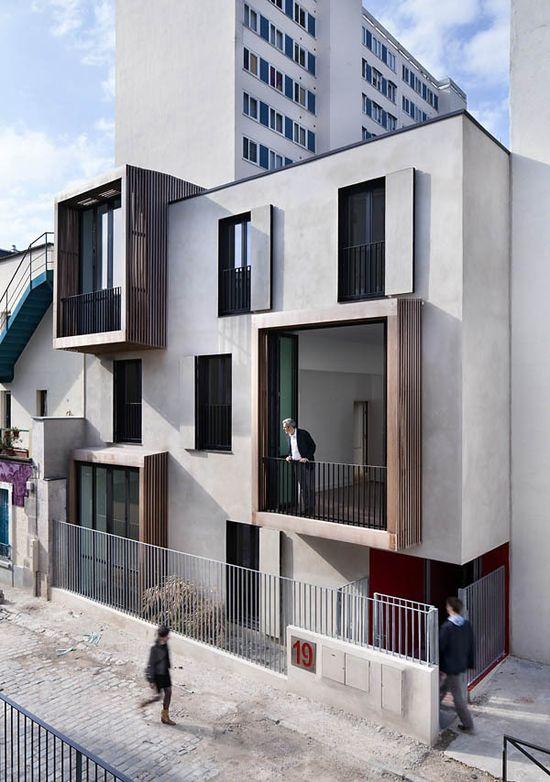 lovely protruding exterior grids -Tetris, social housing and artist studios / Moussafir Architectes