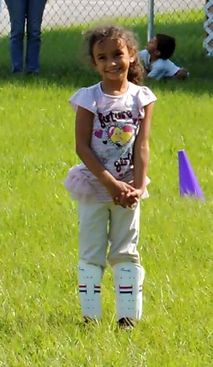 My baby girl playing soccer