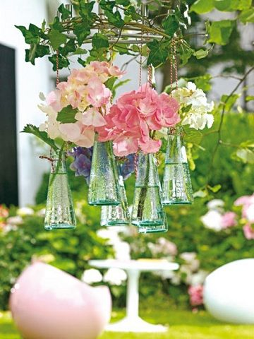 Lovely Spring Idea -  Ivy Covered Grapevine Wreath suspending a small bottle assortment filled with cut blooms...so pretty!