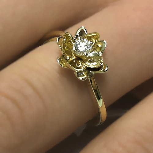 Unique Flower Design 0.10 carats Round Cut Natural Diamond Engagement Ring 14k White or Yellow Gold. $360.00, via Etsy.