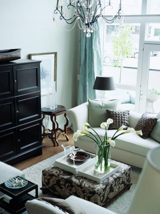 Unsure how to make your small living room seem bigger? Try using calming colors. More space saving ideas: www.bhg.com/...