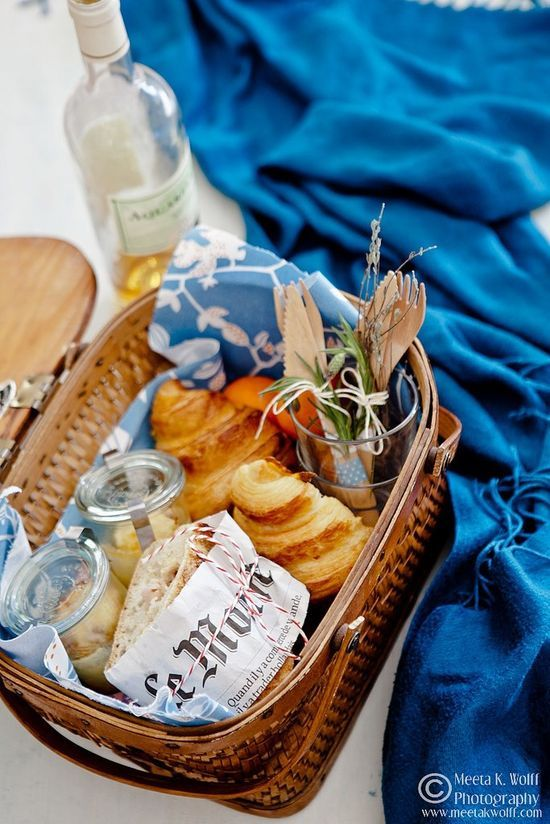Simple picnic for 2 - croissants, sandwiches, muffin/cupcake dessert, tie cutlery and napkin together with a sprig of