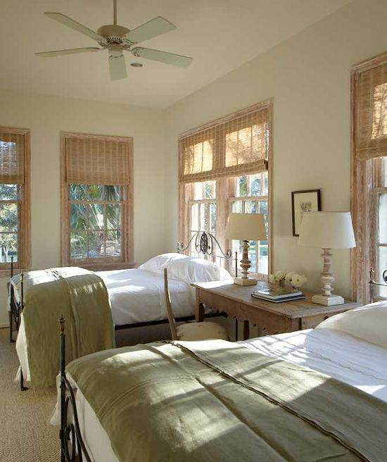 Beds in front of windows