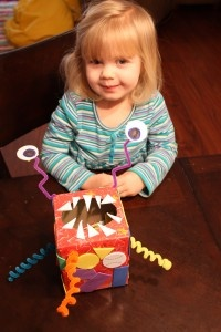 """Terrifyingly cute monster box"" made of tissue box, pipe cleaners, foam/paper scraps, etc. - from No Time For Flashcards"