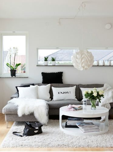 Although I love all-white decor, a white couch always seems impractical. A grey couch seems like a great alternative.