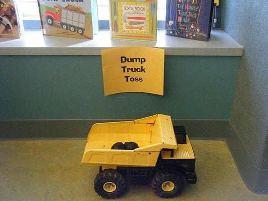 Construction Party Game - dump truck toss.  Bean bags and a Tonka/CAT truck