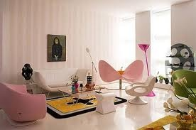 simple and cozy  -light pink and white sofas with a touch of black and yellow carpet and sum apple green color in the side
