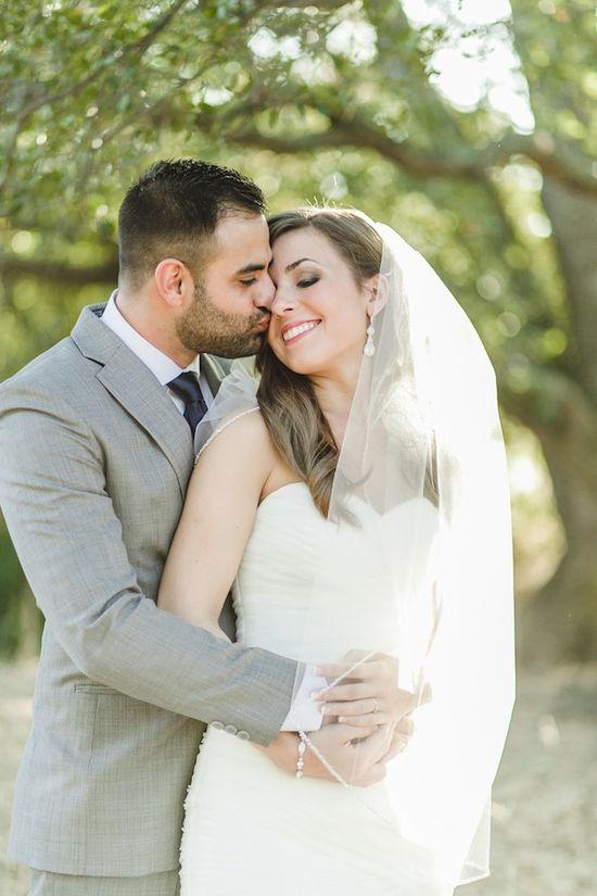 sweet kiss - love the bride's veil too! Anita Martin Photography