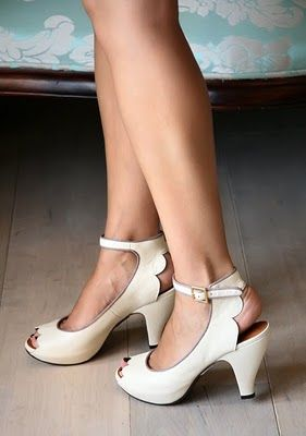 Scalloped peep toe shoes.