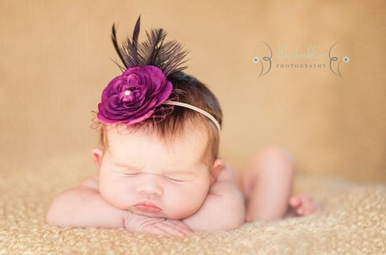 Purple flower with feather, $14.