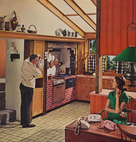 She must really be expecting a lot of calls! :) #vintage #kitchen #home #decor #telephone #phone #1960s