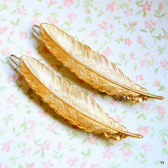 They have to look gorgeous on the hair. Feather Barrettes.