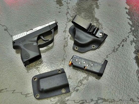 This is a REJck hybrid holster for a Taurus TCP. Black kydex with black hardware. Starting at $35.00. Single mag pouch, kydex shell leather backer with leather belt loops 15.00. I have access to most common handguns and I work with a local FFL for shipping of guns. Contact me about making a sheath for your gun!!! Handmade in U.S.A. Find us on Facebook REJck RedEyedJack custom knives of Bonifay, Florida E-mail