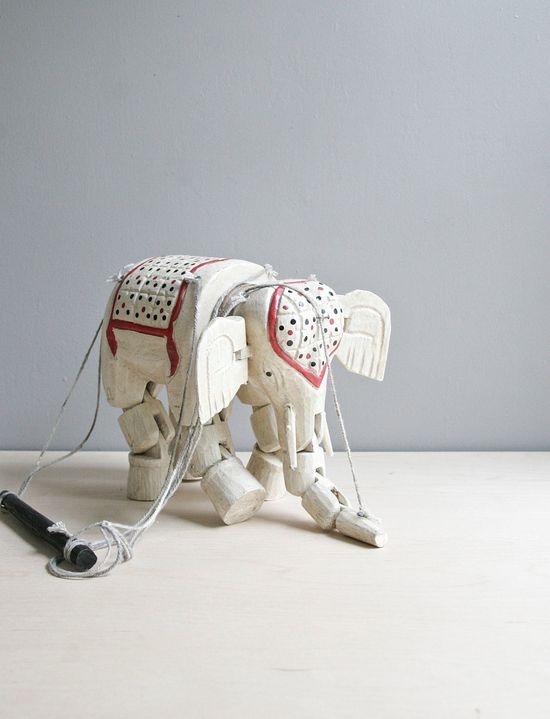 antique wood elephant marionette.