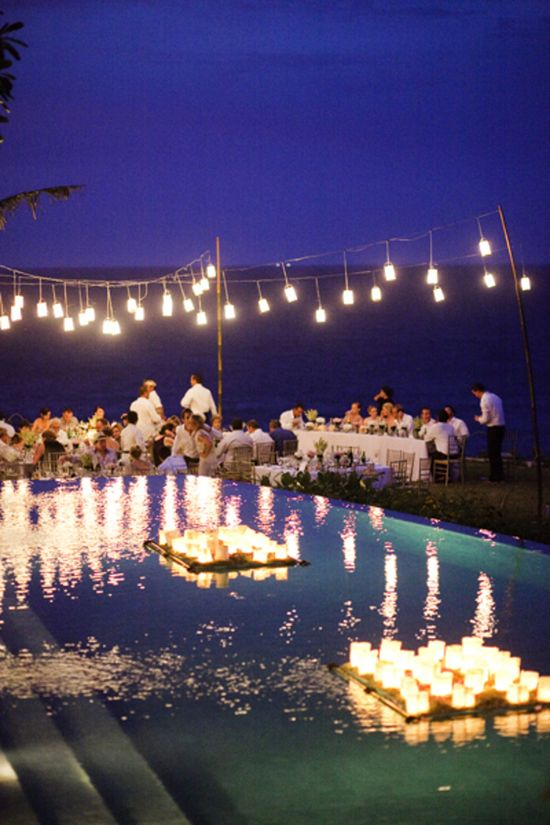 floating candles on pallets in the pool