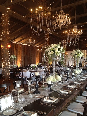 LOVE!!  Barn wedding reception - love the looping lights and the tall, formal centerpieces.