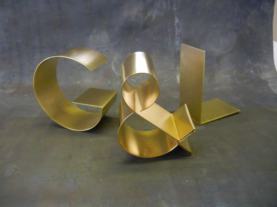Brass letters freestanding. $50.00, via Etsy.
