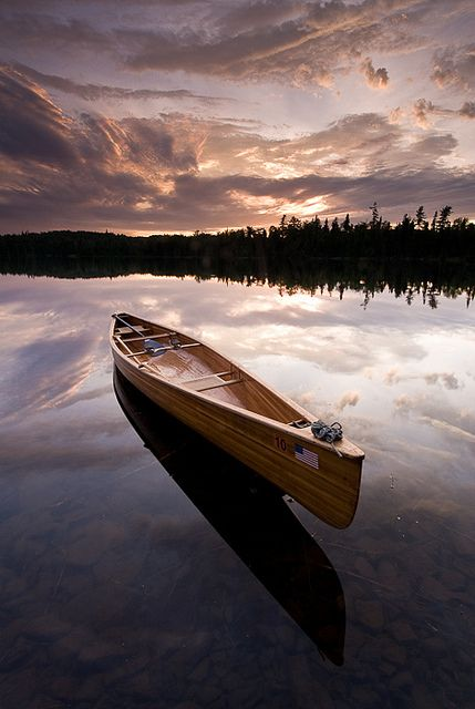 Wooden canoe at sunset on Esther Lake. Minnesota.