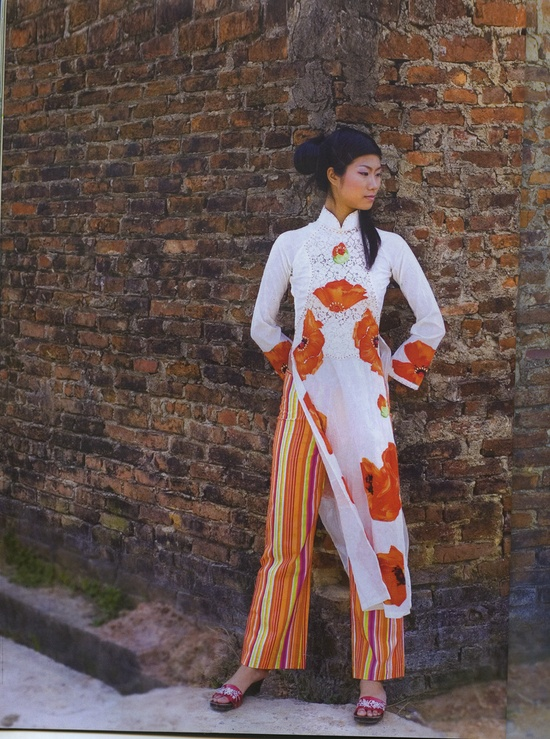 The bright orange coloring and awesome stripes is simply an amazing modern touch to an Ao Dai, Vietnam.