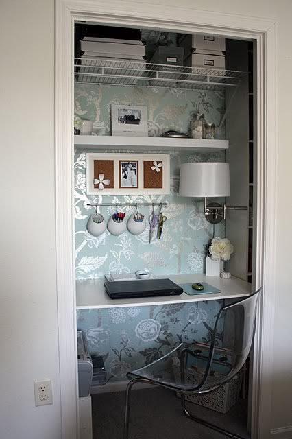 Closet office - great idea if you lack space and work is more important than clothes. Love the way the light bouncing off the wallpaper brightens the space.