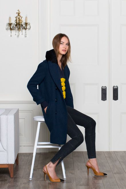 Gorgeous navy peacoat with faux lamb collar.