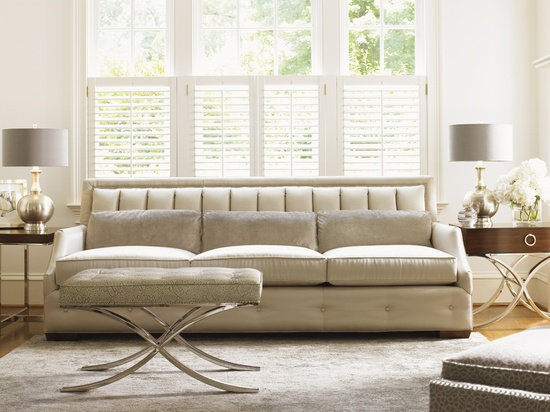 Great details on this sofa - who knew a channel back, tufting and a curved arm could look so great together?
