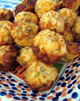 Sausage & Cheese Muffins ....1 lb hot sausage, uncooked;  8 oz cream cheese, softened;  1 1/4 cups Bisquick;  4 oz cheddar cheese, shredded.    Preheat oven to 400F.    Mix all ingredients until well combined.  Roll into 1-inch balls.  Bake for 20-25 minutes or until brown.