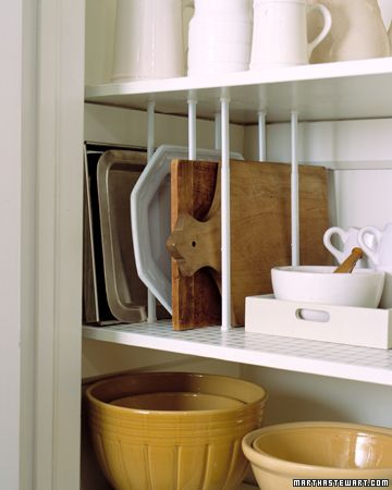 Use tension curtain rods to store platters and cutting boards vertically.