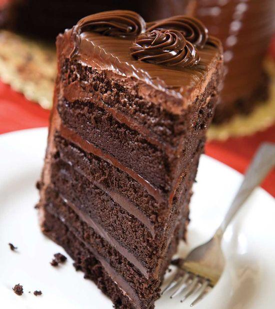 Chocolate Nostalgia Cake Six layers of chocolate cake and fudge. Iced with chocolate buttercream and fudge.