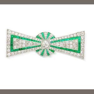 An art deco diamond and emerald bow brooch,