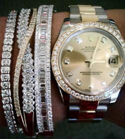 Rolex and diamond bracelets.