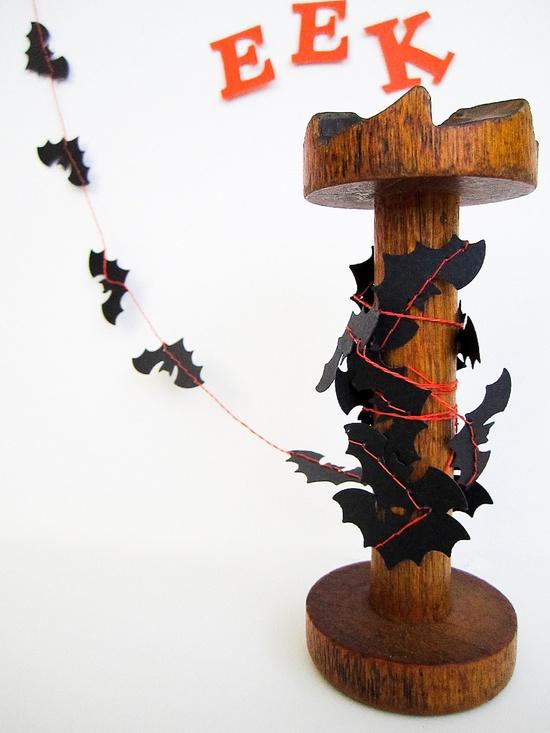 A garland of tiny paper bats.